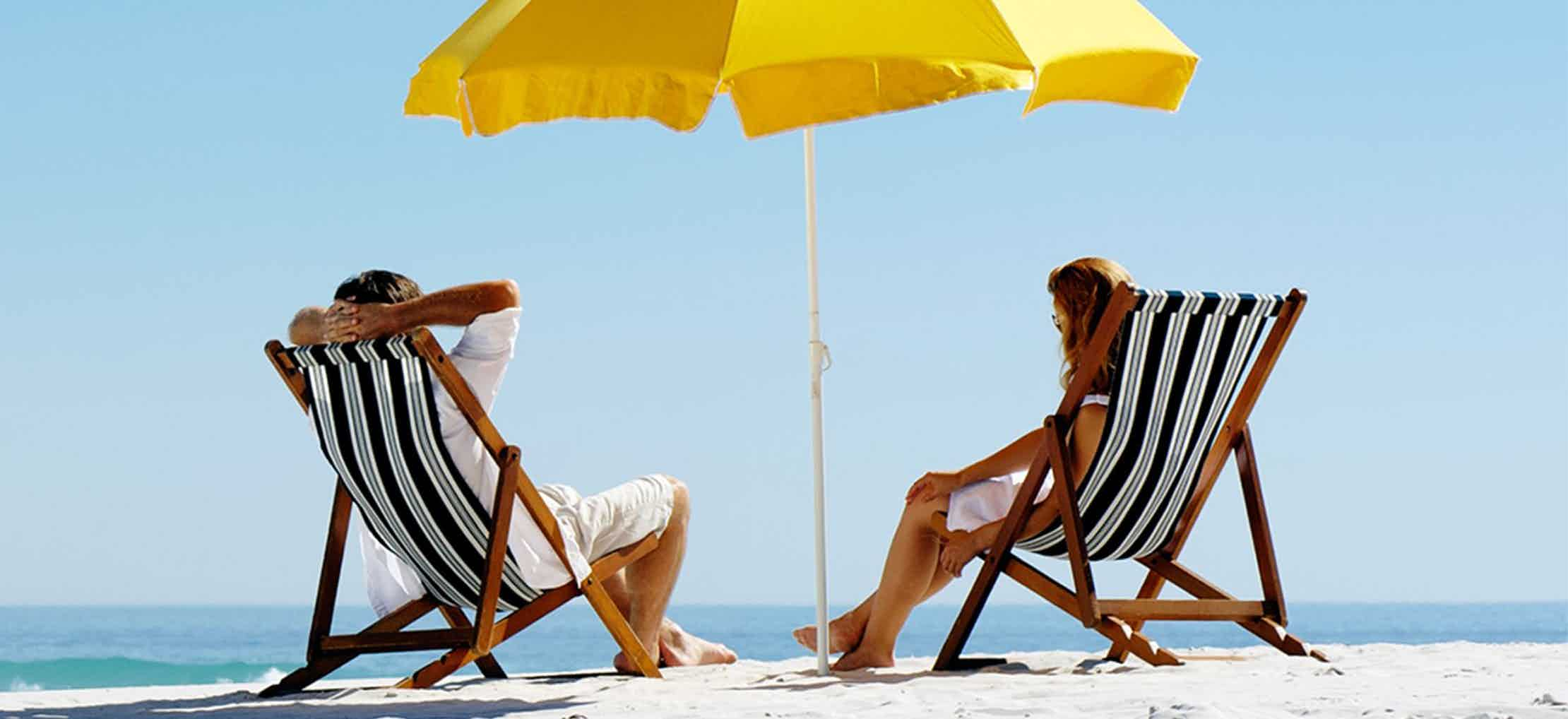 Couple sitting in beach chairs on the beach