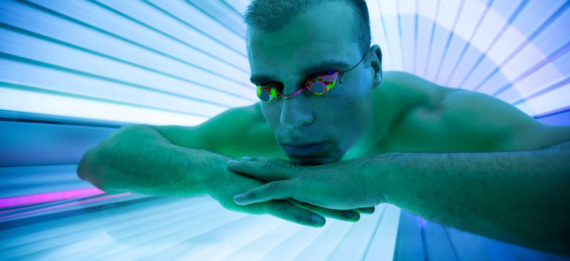 Man in tanning bed